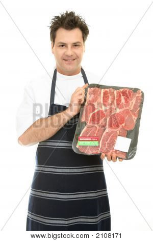 Butcher With Tray Of Steak