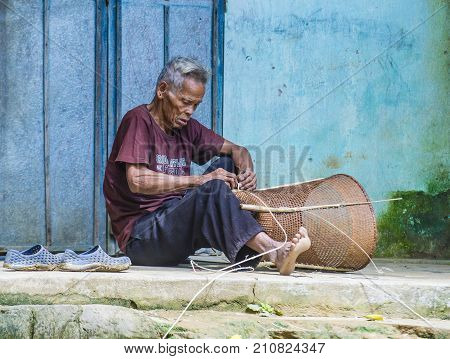 QUANG NAM VIETNAM - OCT 07 : Portrait of a man from the Cotu Minority in Quang Nam Vietnam on October 07 2017. The Cotu minority mostly live in central Vietnam and eastern Laos
