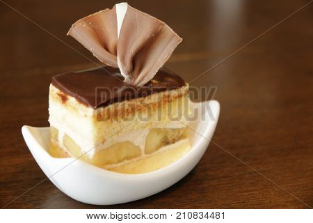 A Chocolate mini cake topped with a fan-choc on top