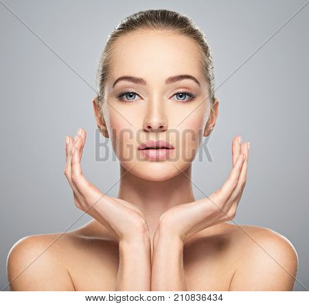 Beautiful face of young caucasian woman with perfect health clean skin.  Skin care treatment. Portrait of an Attractive girl with calm emotion, closeup. Pretty  and sexy female with stunning look.