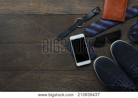 Top view of accessory for travel and technology background concept.Mix of variety essential items on the modern rustic table home office.Necessary object for adult or teenage and travel to holidays.
