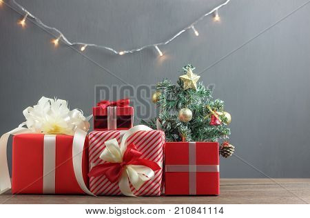 Sign decoration & ornaments of Merry Christmas & Happy new year concept.Mix gifts box and items with bulb lighting on the modern rustic wood at home studio desk.Free space for creative design text.