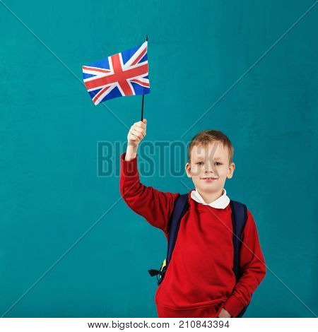 School Holidays In Great Britain. Little Schoolboy With National Flag Of The United Kingdom Having F