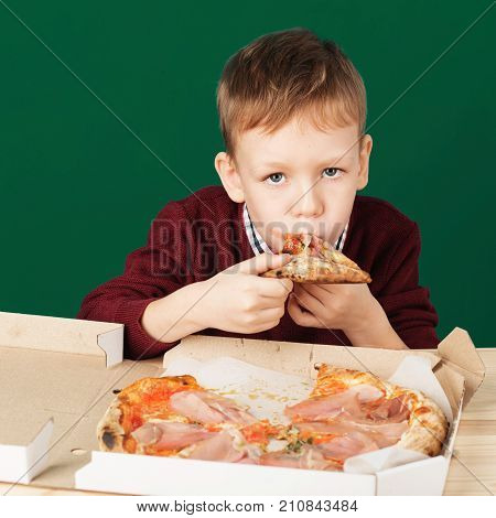 Children Eat Italian Pizza In The Cafe. School Boy Eating Pizza Slice From The Box At Fast Food Rest