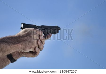 Semi auto handgun just starting to cycle after a shot