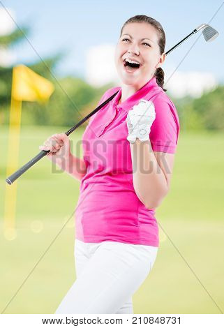 Happy Golfer Jubilant On A Background Of Golf Courses With A Golf Club