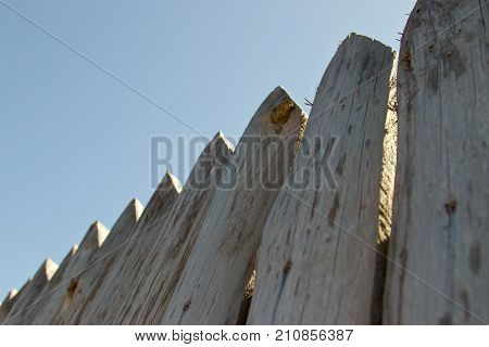 Fence, Palings Of Unrefined Wood. The Russian Village.