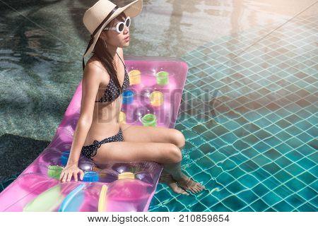 Portrait Of Beautifu Woman Relaxing In Bikini And Big Hat In Swimming Pool