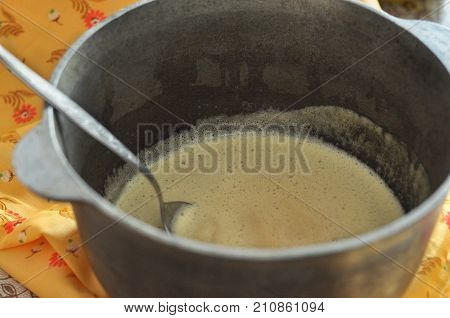 Mixed Batter And A Spoon In Cast-iron Bowl, Close-up, Selective Focus. Process Of Cooking