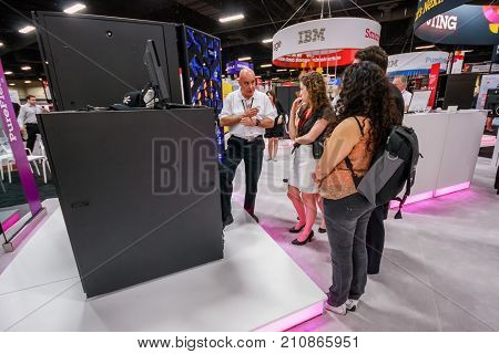 LAS VEGAS NV - JUNE 10 2013: Attendees listen stand-attendant at Intel booth of exhibition in frame of IBM Edge 2013 conference on June 10 2013 in Las Vegas NV