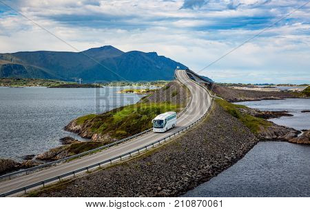 Tourist bus traveling on the road in Norway. Atlantic Ocean Road or the Atlantic Road (Atlanterhavsveien) been awarded the title as