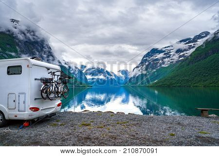 Family vacation travel RV, holiday trip in motorhome, Caravan car Vacation. Beautiful Nature Norway natural landscape. poster