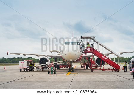 CHIANG RAI THAILAND - OCTOBER 17 2016: unloading of baggage from the Air Asia aircraft in Bangkok airport on October 17 2016. Air Asia company is the largest low cost airlines in Asia