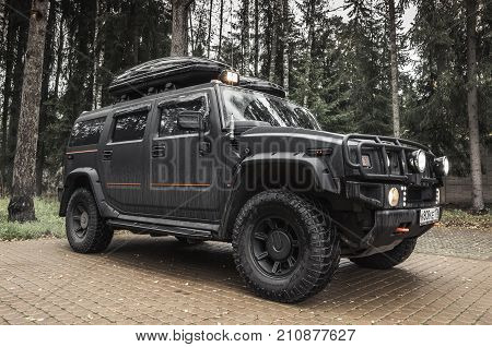 Black Hummer H2 Stands On Rural Parking