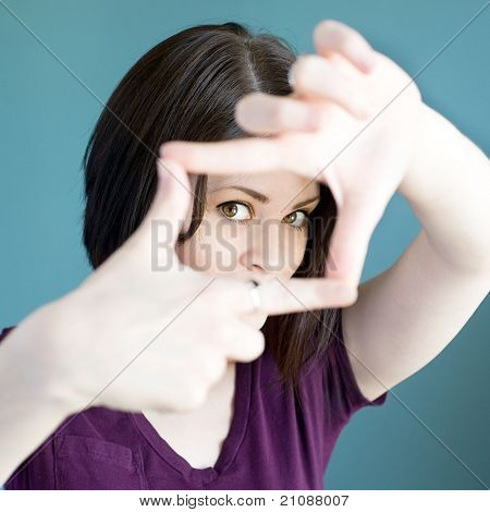 Woman Making Finger Frame Around Her Face