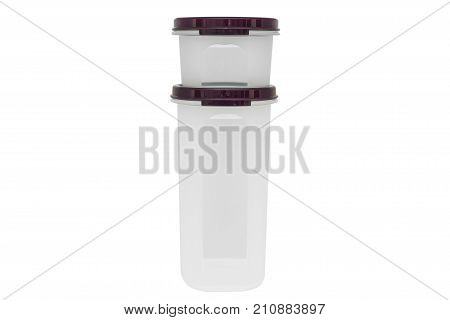 Close up two plastic cups with purple lids stacked on each other
