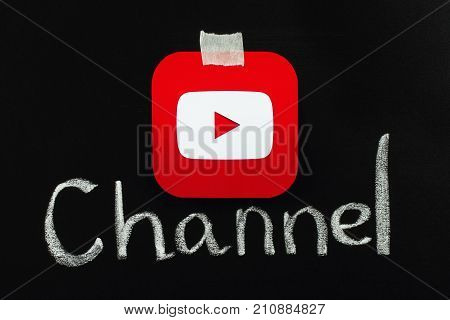 Kiev Ukraine - September 4 2017: Youtube icon printed on paper and placed on blackboard with chalk word channel. YouTube is a video-sharing website