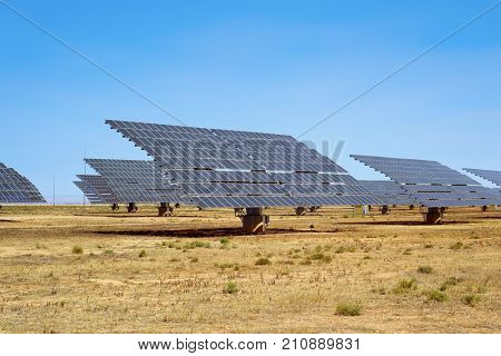 a view of some solar panels in a solar power plant in a desert landscape