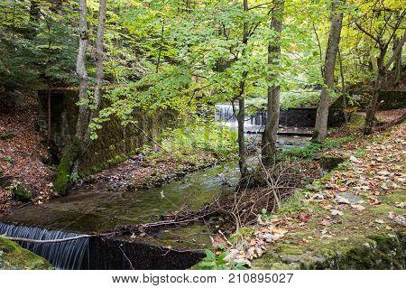 The stream Pelesului in the garden of Peles castle in Sinaia in Romania