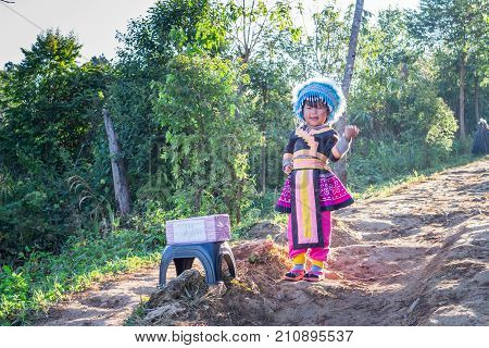 CHIANG RAI THAILAND - Unidentified ethnic minority girls in a traditional dress on January 27 2015 in Chiang Rai Thailand. Chiang Rai is a northernmost province in Thailand