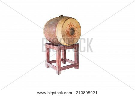 Yellowish old large drum with drum skin fully visible isolated on white with clipping path. The drum is used in temple to notify the time for midday meal. The drum skin side is typically as large as half of human height