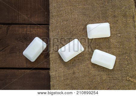 Hand washing with hand soap is healthier, natural hand soaps, beauty soaps on wooden floor,