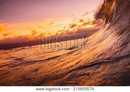 Ocean wave breaking down at sunset or sunrise time. Wave and with warm sunset or sunrise colors