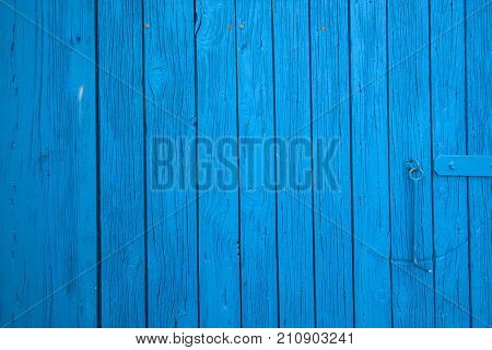 Blue farm barn shed door as texture or background