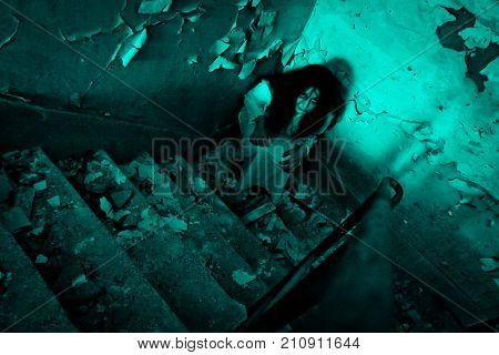 Horror Scene. A scary woman in abandoned and old demolished room