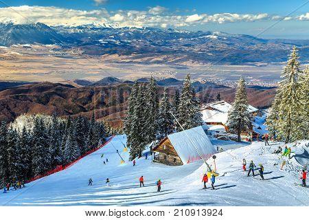 Wooden chalets and spectacular ski slopes in the Carpathians, Poiana Brasov ski resort, Transylvania, Romania, Europe