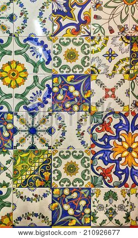 Detail of the traditional decorative tiles with majolica patterns. Spain traditional tiles. Floral ornament.