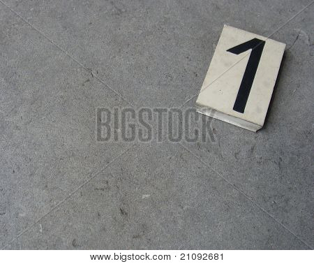 Plastic 1 One Number On Gray Stone Surface