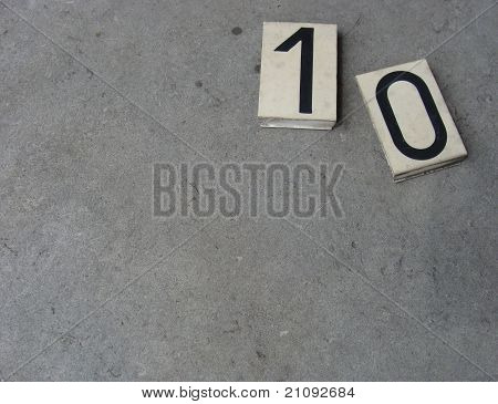 Plastic 10 0 1 Zero Ten One Number On Gray Stone Surface
