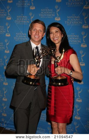 LOS ANGELES - JUN 17:  Brad Bell,  Christine Lai-Johnson in the Press Area  at the 38th Annual Daytime Creative Arts Emmy Awards at Westin Bonaventure Hotel on June 17, 2011 in Los Angeles, CA
