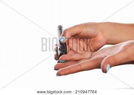 Woman's Hands Using Lancet Pen