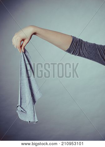Person Holding Smelly Rag.