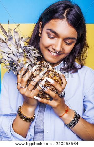 lifestyle people concept. young pretty smiling indian girl with pineapple, asian summer fruits close up