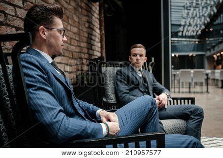 Two young gentleman having conversation