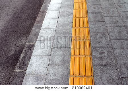 tactile paving for blind handicap on tiles pathway walkway for blindness people.