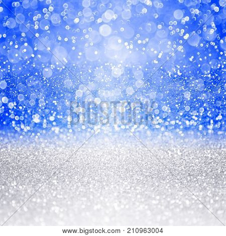 Abstract blue silver glitter sparkle background for happy birthday party invite, Hanukkah, Chanukah, Bar Mitzvah, Israel Independence Day, Christmas, winter snowfall or New Year's Eve