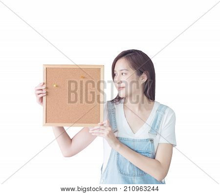 Closeup asian woman with cork board in hand and look at the space in cork board isolated on white background with clipping path