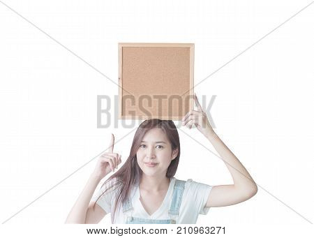 Closeup asian woman with cork board in hand and point to space in cork board isolated on white background with clipping path