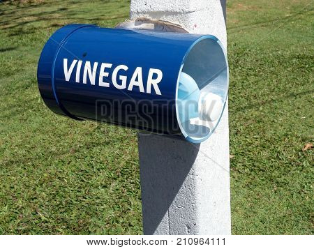 A container for vinegar at the beachside for treatment of stingers