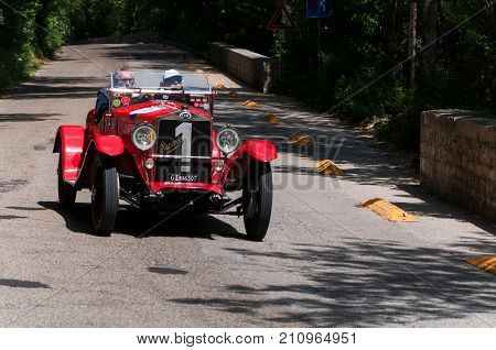 GOLA DEL FURLO, ITALY - MAY 19: O.M. 665 SPORT SUPERBA 2000 CM3 1927 on an old racing car in rally Mille Miglia 2017 the famous italian historical race (1927-1957) on May 19 2017