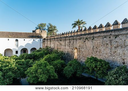 Cordoba, Spain - April 11, 2017: Castle of the Christian Kings, Alcazar de los Reyes Cristianos, it is a medieval fortress located in the historic centre of Cordoba, next to the Guadalquivir River and near the Grand Mosque.