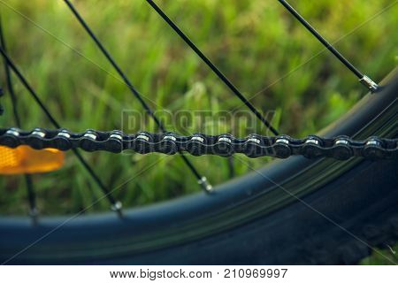 Healthy lifestyle concept - mountain bike wheel with chain
