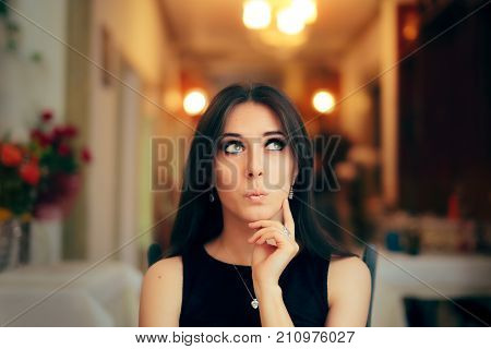 Cute Girl Thinking about Her Plan at Dinner Party