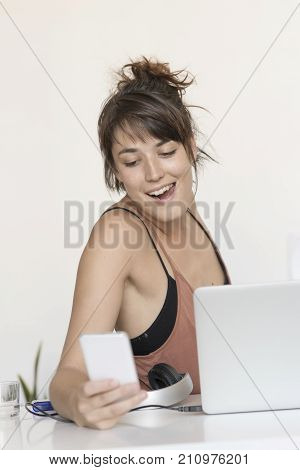 Young And Pretty Startup Worker Using A Moblie Phone