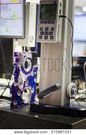 aluminium part inspected by height gauge ; selective focus