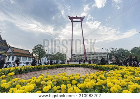 BANGKOK THAILAND - OCTOBER 26: Unidentified people gather for the cremation of Rama 9 the former king at the giant swing surrounded by marigolds in Bangkok Thailand on October 26 2017.